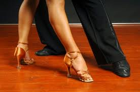 Picture of male and female dancers legs and shoes